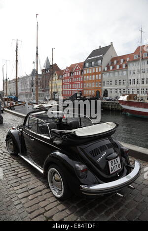 A classic black Volkswagen Beetle car in Nyhavn, Copenhagen, Denmark. Unique registration plate 'DAS AUTO' - Stock Photo