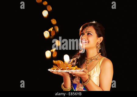 indian ladies diwali Festival with  Gold Money - Stock Photo