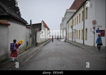 A little girl carries her 'Schultuete' (literally = schoolbag) - a cornet of cardboard filled with sweets and presents. - Stock Photo