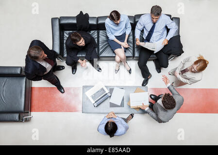 Executives in meeting, overhead view - Stock Photo