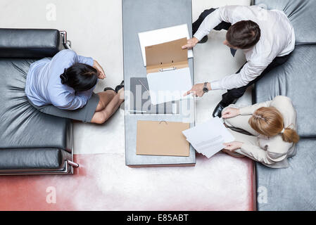 Executives in business meeting, overhead view - Stock Photo