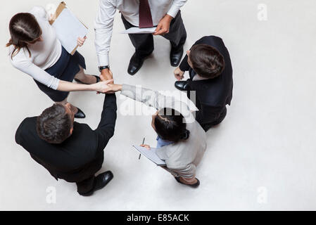 Executives shaking hands, overhead view - Stock Photo