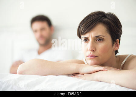 Couple not speaking after disagreement in bed - Stock Photo