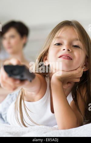 Little girl holding remote control - Stock Photo