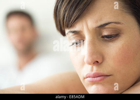 Woman contemplative and withdrawn after disagreement with husband - Stock Photo