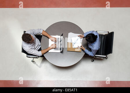 Interns working in shared office space - Stock Photo