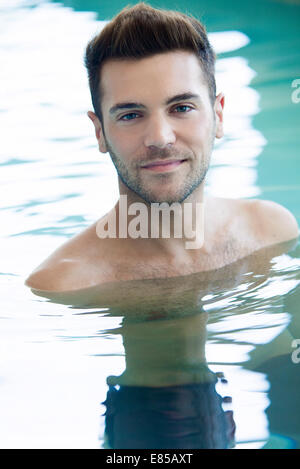 Young man in swimming pool - Stock Photo