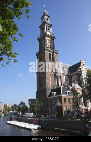Westerkerk church by Prinsengracht canal Amsterdam Holland - Stock Photo