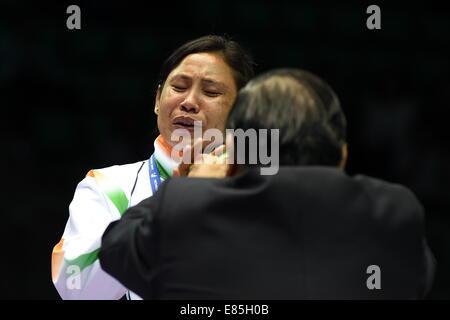 Incheon, South Korea. 1st Oct, 2014. Devi Laishram Sarita of India reacts during the awarding ceremony of the women's - Stock Photo