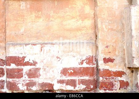 Old dilapidated brick wall of red brick - Stock Photo