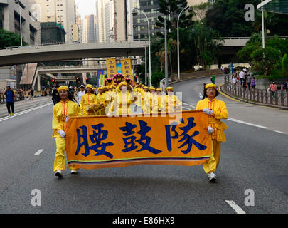 Hong Kong. 1st October, 2014. procession through Wan Chai & Admiralty,slogans against the Communist party for various - Stock Photo