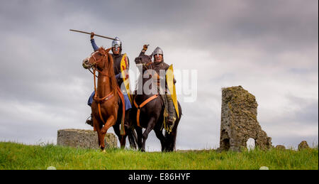 Pevensey Castle, East Sussex, UK. 1st October, 2014. Norman Cavalry scouts set off from Pevensey Castle in East - Stock Photo
