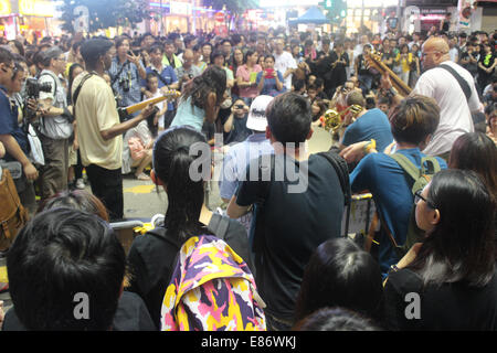 Hong Kong. 1st October, 2014.  Hong Kong Protests: Musicians -- including Hong Kong-based American guitarist A.B.A. - Stock Photo