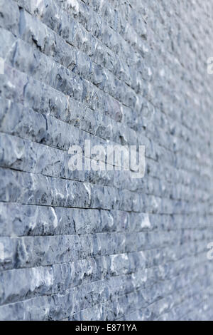 Brick wall background texture in shallow depth of field - Stock Photo