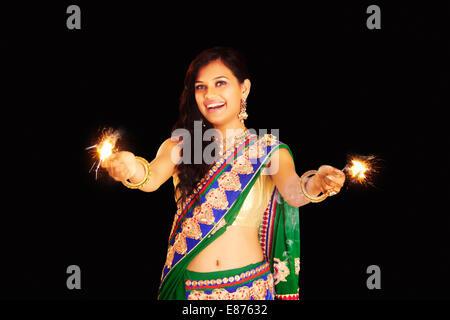 indian ladies diwali Festival fun  Fire Cracker - Stock Photo