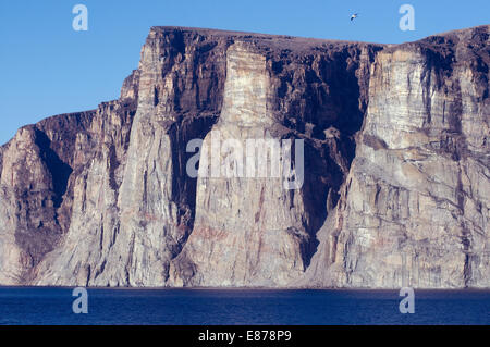 Within Gibbs Fjord on the Arctic's Baffin Bay are cliffs millions of years old and as timeless as earth's creation - Stock Photo
