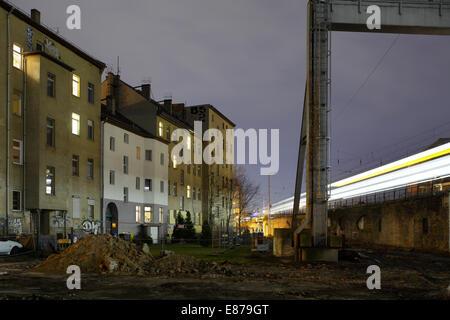 Berlin, Germany, old buildings and passing S-Bahn in Berlin-Rummelsburg - Stock Photo