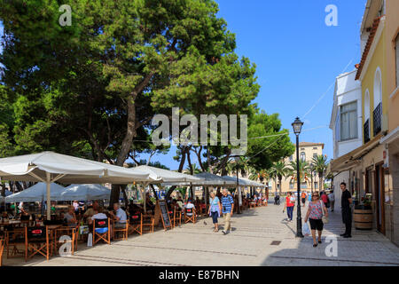 Cafes and outside tables and chairs in Placa des Pins, Ciutadella, Minorca, Spain - Stock Photo