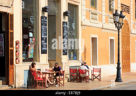 People taking refreshments at tables outside  cafes and bars in Placa des Born, Ciutadella, Menorca, Spain - Stock Photo