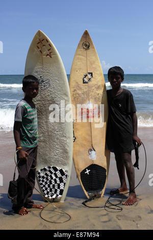 Portrait of young local surfers in Mamallapuram,Kanchipuram,Tamill Nadu,South India,India,Asia. - Stock Photo