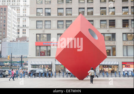 Isamu Noguchi's Red Cube on the plaza in front of 140 Broadway in Lower Manhattan was installed in 1968. - Stock Photo