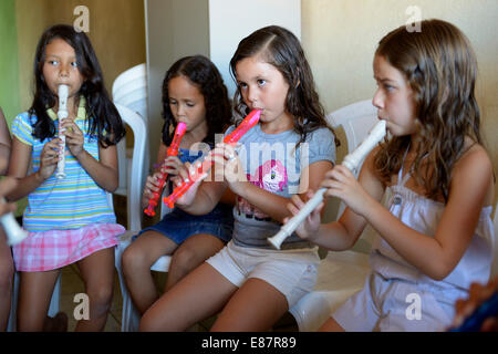 Music lessons, children learning to play the recorder, Ponta da Serra, Crato, State of Ceará, Brazil - Stock Photo
