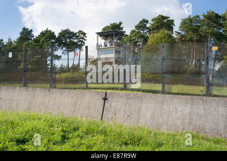 Former inner German border, death zone, border fence and car ditch, American observation tower at the back - Stock Photo