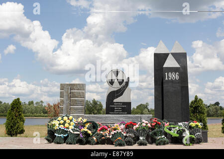 The monument with wreaths commemorating the 28th year of Chernobyl Disaster. Belarus, the most polluted country, - Stock Photo