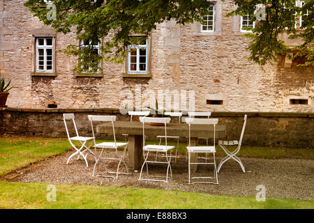 Chairs and tables outside, Schloss Huelsede, moated Castle in Huelsede, Weser-Renaissance, Lower Saxony, Germany, - Stock Photo