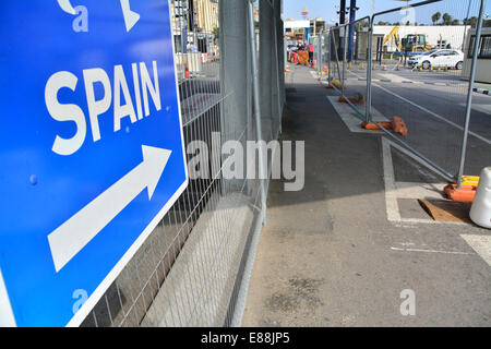 Gibraltar. 2nd October, 2014.  View of border exit into Spain where pedestrians and vehicles merge as they cross - Stock Photo