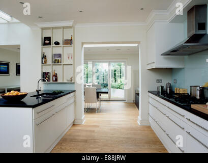 White units with black granite worktops by magnet in stylish kitchen stock photo royalty free - Stylishly modern kitchen islands additional work surface ...