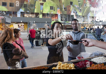 Sept. 30, 2014 - Rotterdam, South Holland, The Netherlands, Holland - Visitors of the Markthal trying sweet Turkish - Stock Photo