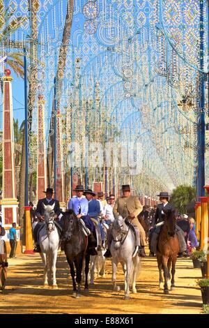Spanish horse riders in traditional dress at annual Horse Fair, Jerez de la Frontera, Cadiz Province, Andalusia, - Stock Photo