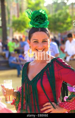 Woman in traditional Spanish costume, Annual Horse Fair, Jerez de la Frontera, Cadiz Province, Andalusia, Spain, - Stock Photo