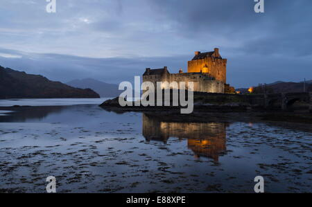 A twilight view of Eilean Donan Castle, Highlands, Scotland, United Kingdom, Europe - Stock Photo