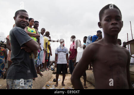 Fisherman in the Monrovian township of West Point in Liberia. Fisherman in West Point are suspected of bringing - Stock Photo