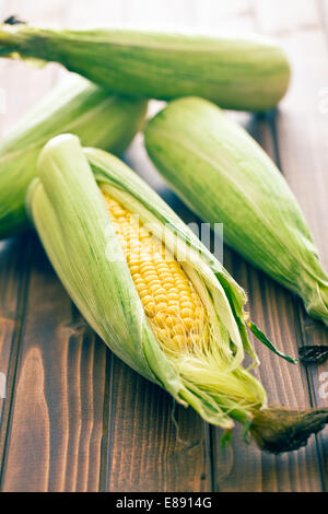 the sweet corn on wooden table - Stock Photo