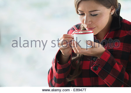 Woman enjoying hot cocoa - Stock Photo
