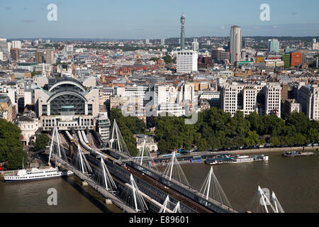 Charing Cross Station,Hungerford Bridge and the view of the BT Tower looking north from the South Bank - Stock Photo