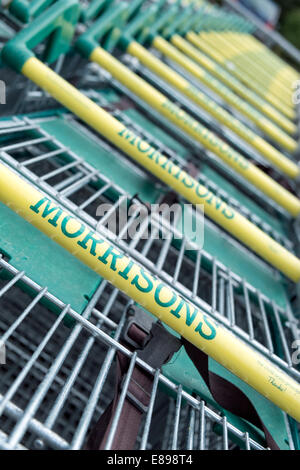 Stacked Morrisons shopping trolleys, UK. Shot with narrow depth of field - Stock Photo