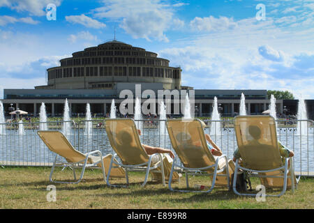 People on deckchairs at the Centennial Hall (designed by Max Berg, built in 1911–1913, listed on UNESCO Site in - Stock Photo