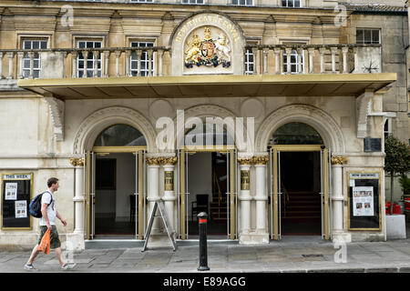 A pedestrian walking past the entrance to the historic New Theatre Royal in the world heritage city of Bath, Somerset, - Stock Photo