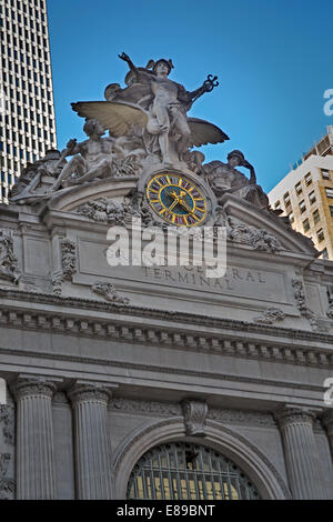 Statue of Mercury and tiffany clock at the top of the Grand Central Terminal 42nd Street Entrance. - Stock Photo