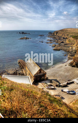 Lizard point head Cornwall rugged coast coastline boat house slipway beach sea most southerly point in UK England, - Stock Photo