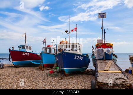 Fishing boats on shingle beach in Beer - Stock Photo