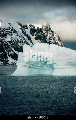 Mountains and icebergs near the Lemaire Channel in Antarctica - Stock Photo