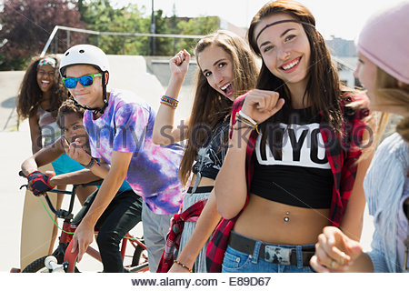 Portrait of smiling teenagers cheering - Stock Photo