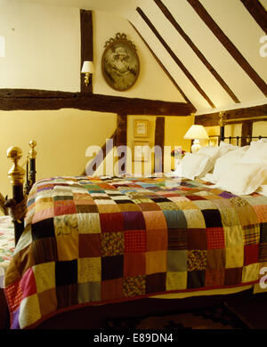 Colourful patchwork quilt on bed in country bedroom with large ... : colourful patchwork quilt - Adamdwight.com