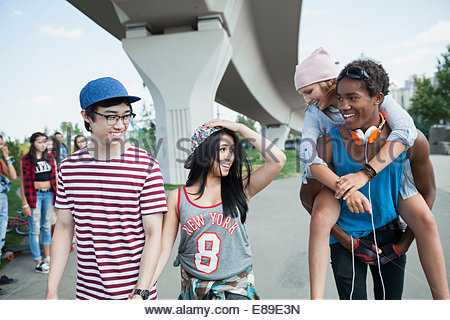 Teenage couples hanging out - Stock Photo