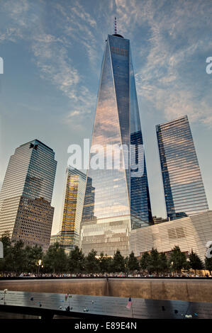 911 Memorial Reflecting Pools along with One World Trade Center commonly known as the Freedom Tower. - Stock Photo